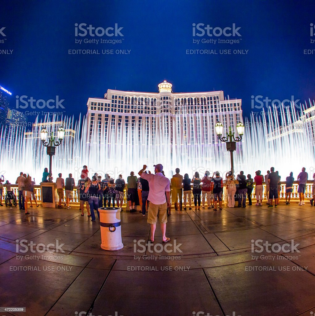 people watch famous Bellagio Hotel with water games stock photo
