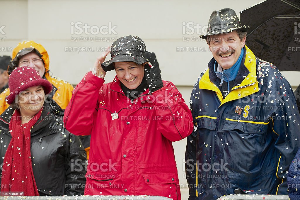 People watch parade at Basel Carnival in Basel, Switzerland. stock photo