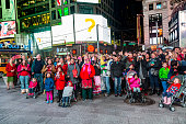 people watch  public TV show  at Times Square