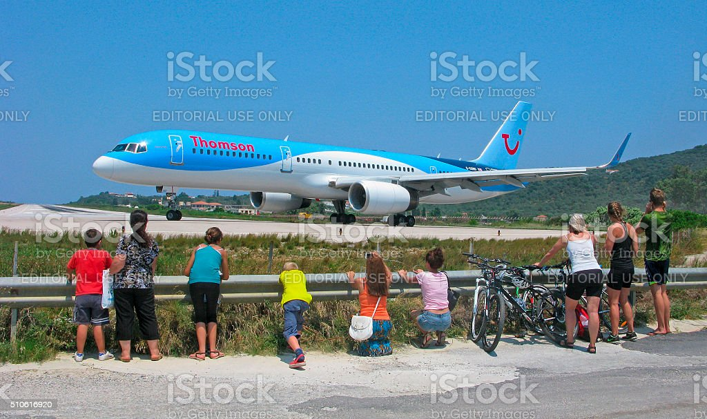 People watch the airplane stock photo