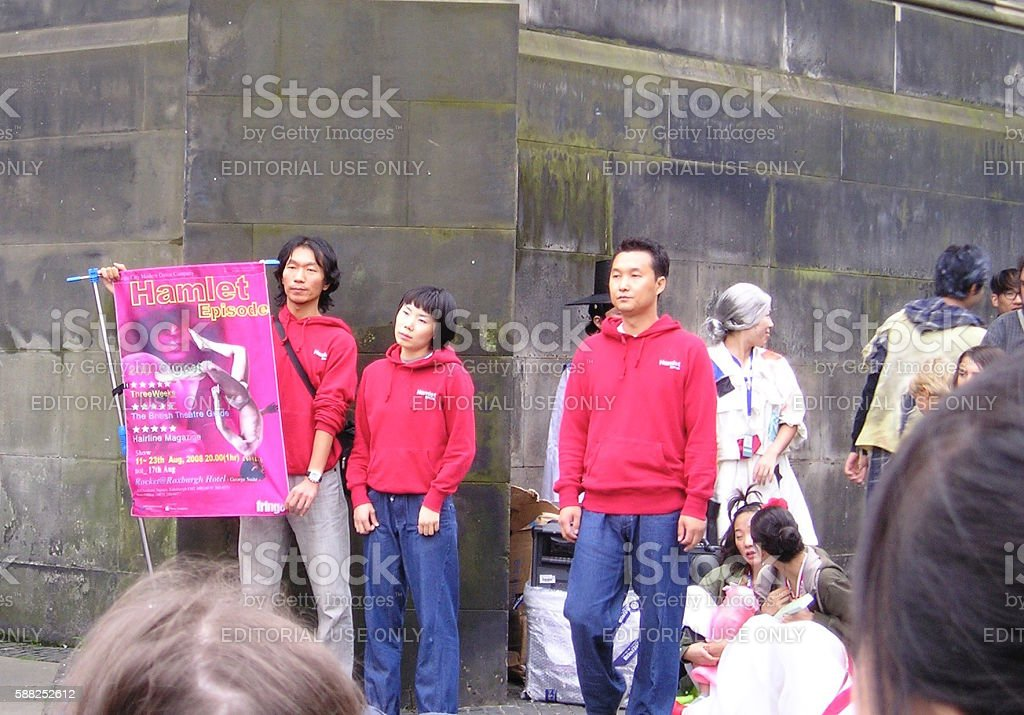 People watching a dance performance in the street stock photo
