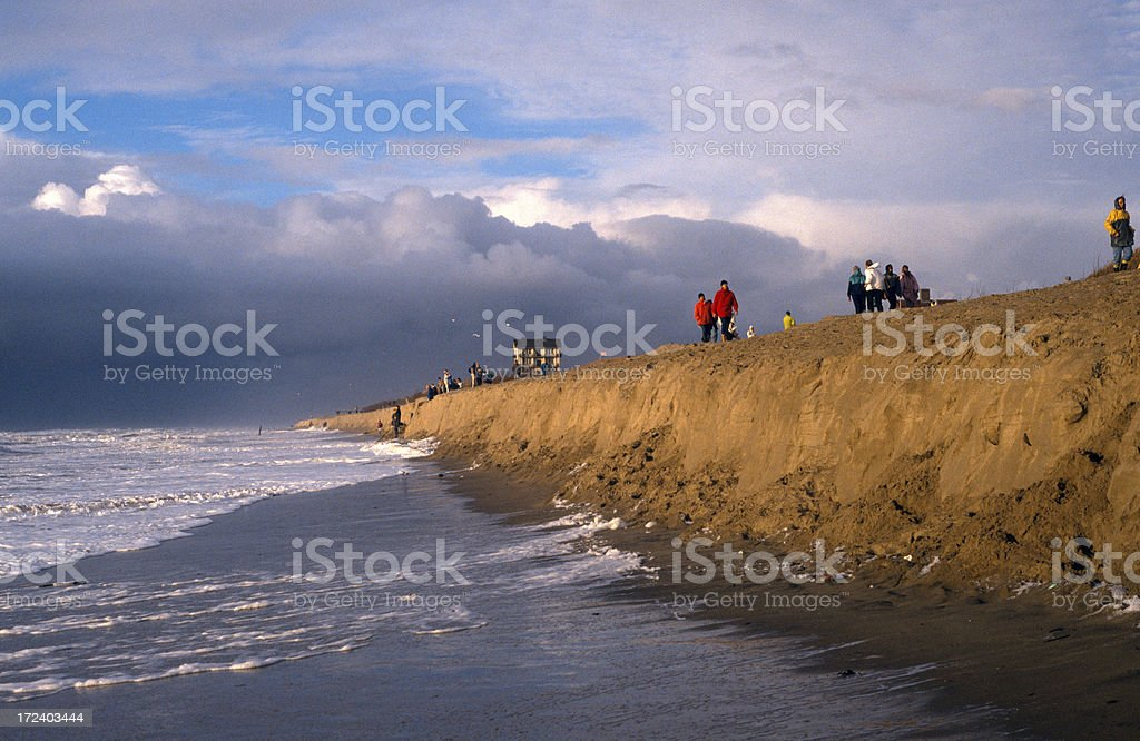 People watching a november storm stock photo