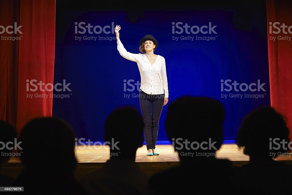 People watching actress on theater stage during play stock photo