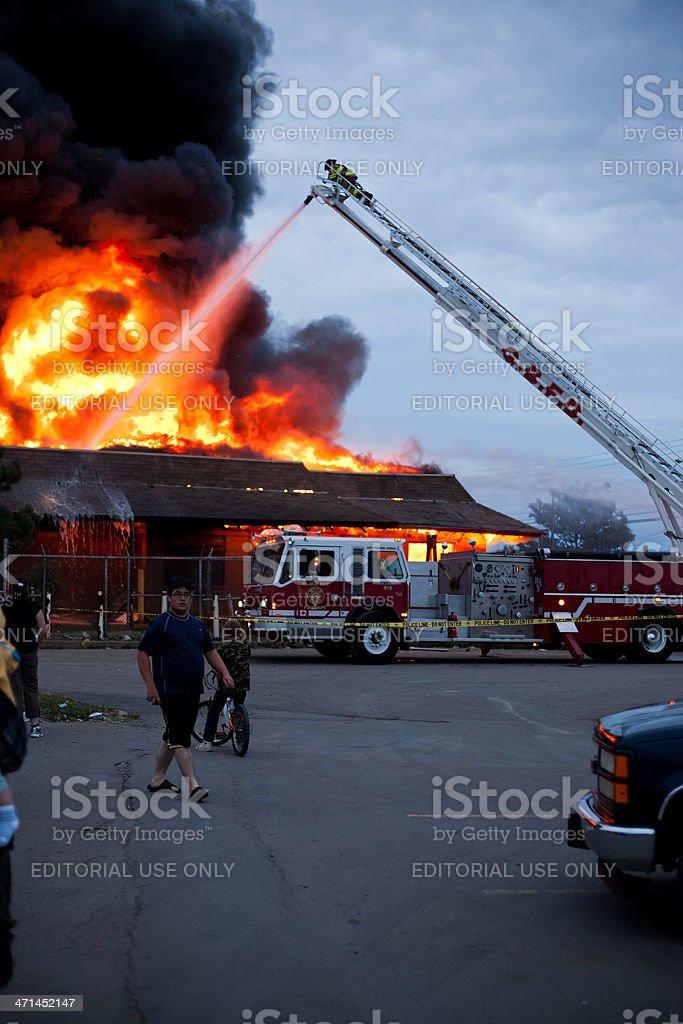 People Watching Firemen Battle Blaze royalty-free stock photo