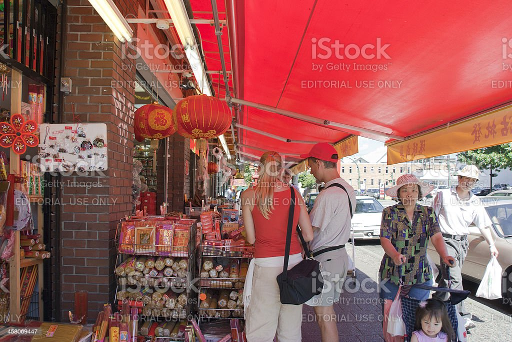 People watching goods in Chinatown of Vancouver royalty-free stock photo
