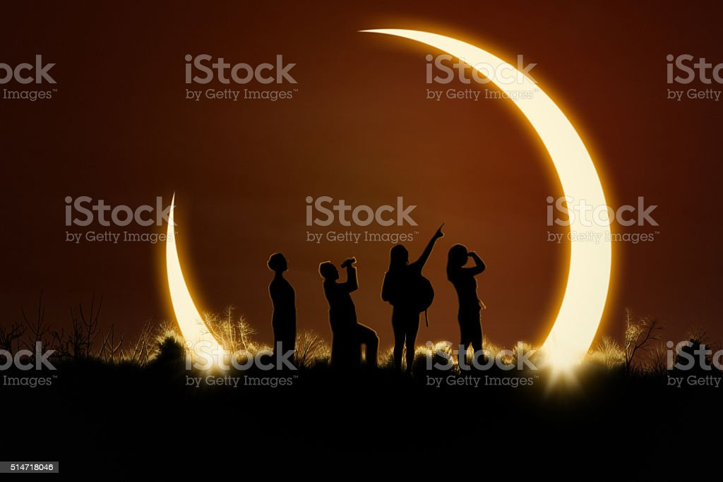 People watching solar eclipse stock photo
