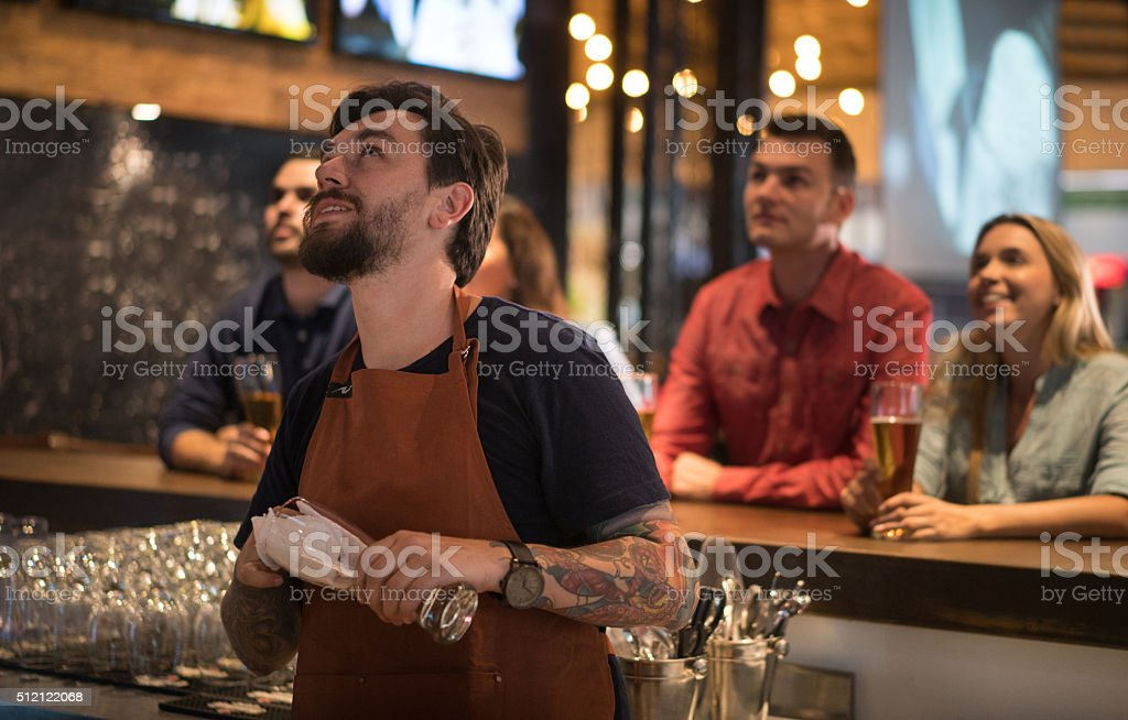 People watching sports at the bar stock photo