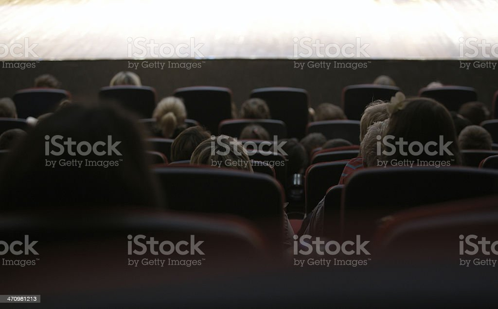 People watching stage performance stock photo