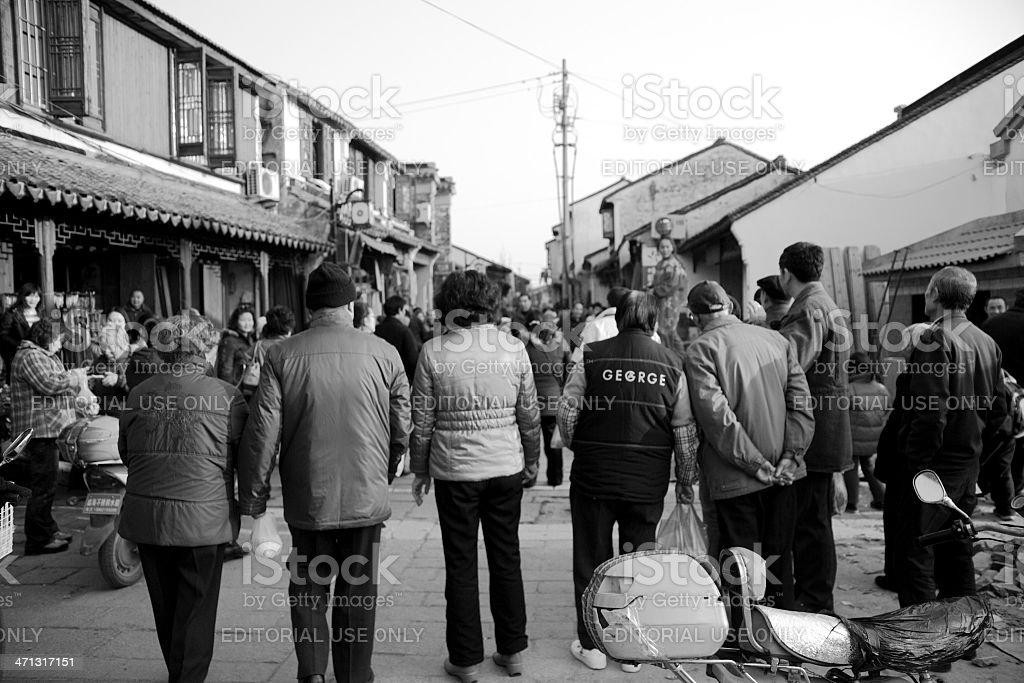 People watching street acrobatics stock photo