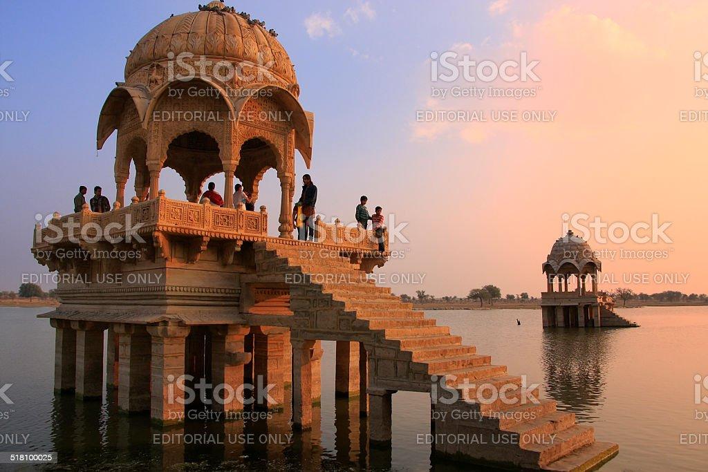 People watching sunset at Gadi Sagar temple on Gadisar lake stock photo