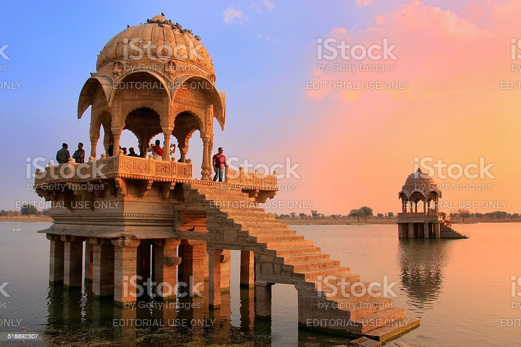 People watching sunset at Gadi Sagar temple on Gadisar lake stock photo