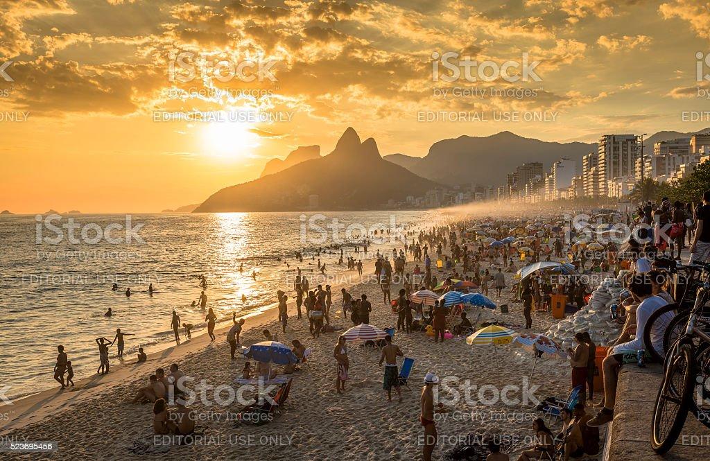 People watching sunset on iconic Ipanema Beach stock photo