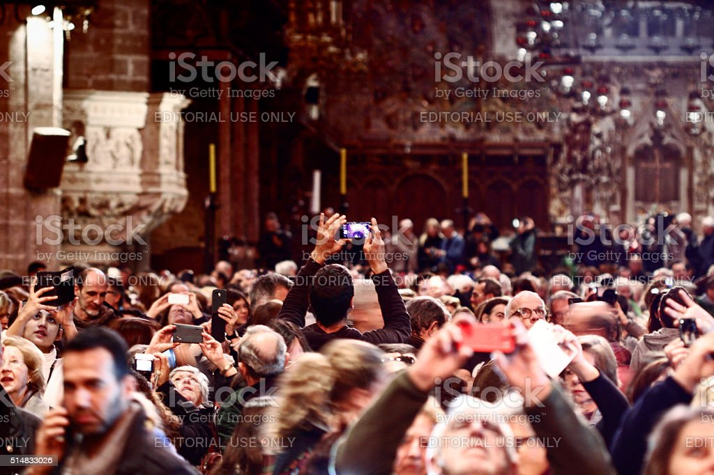 People watching the spectacle of the cathedral. stock photo