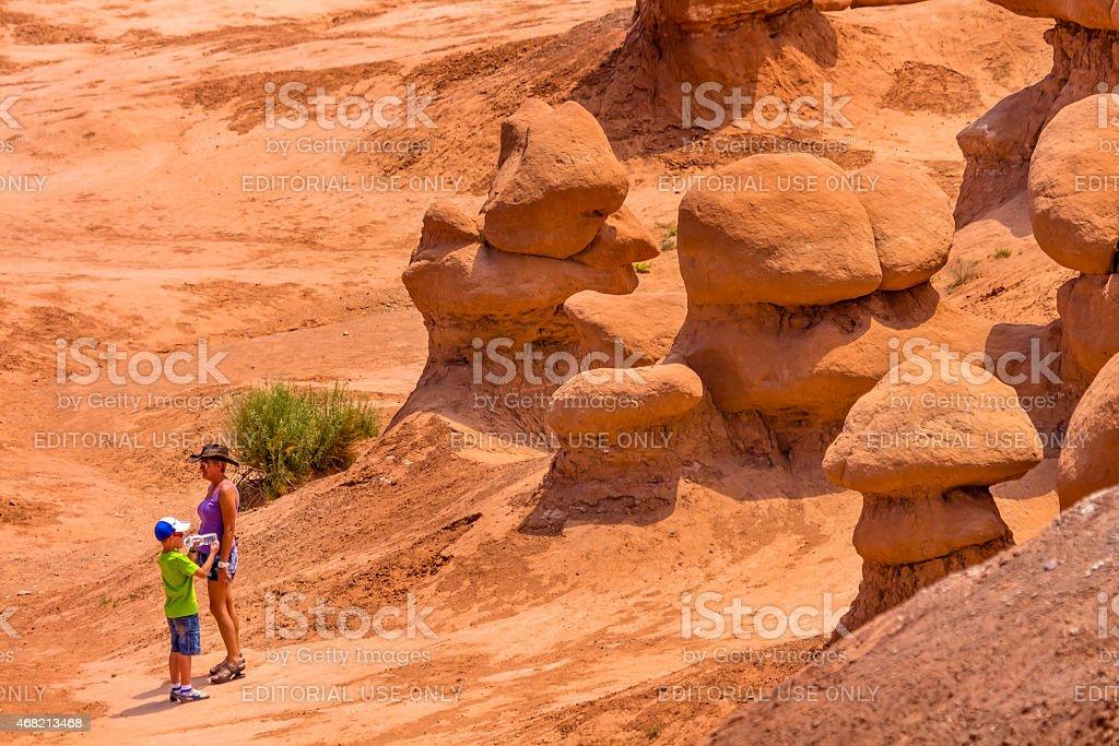 People Waterbreak  Walking Hoodoos Goblin Valley State Park Utah stock photo