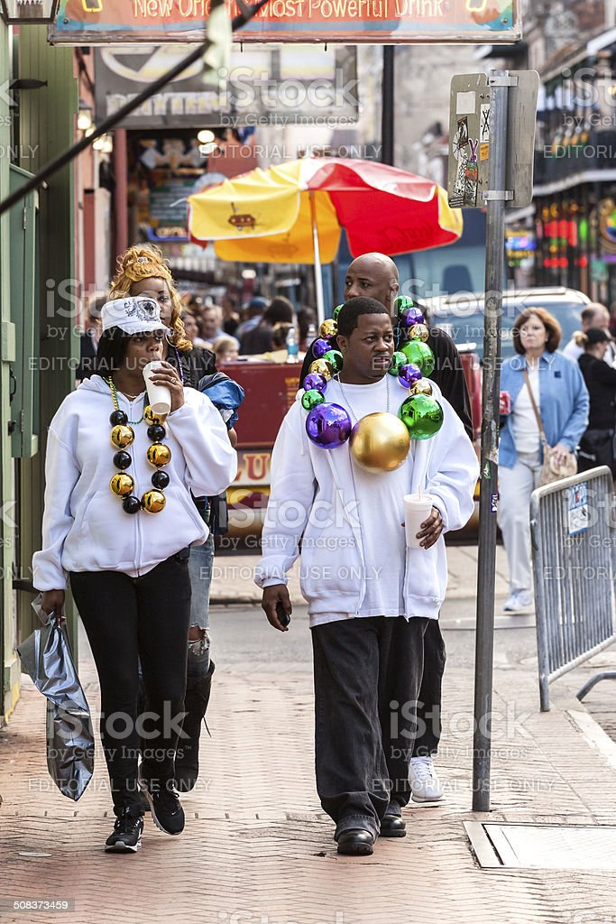 People wearing funny costumes celebrating famous Mardi Gras. royalty-free stock photo