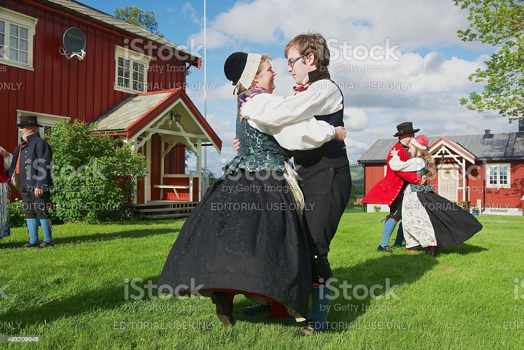 People wearing historical costumes perform traditional dance in Roli, Norway. stock photo