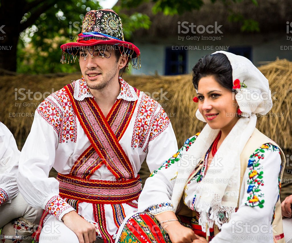 close up image of people wearing traditional Romanian clothing in the...