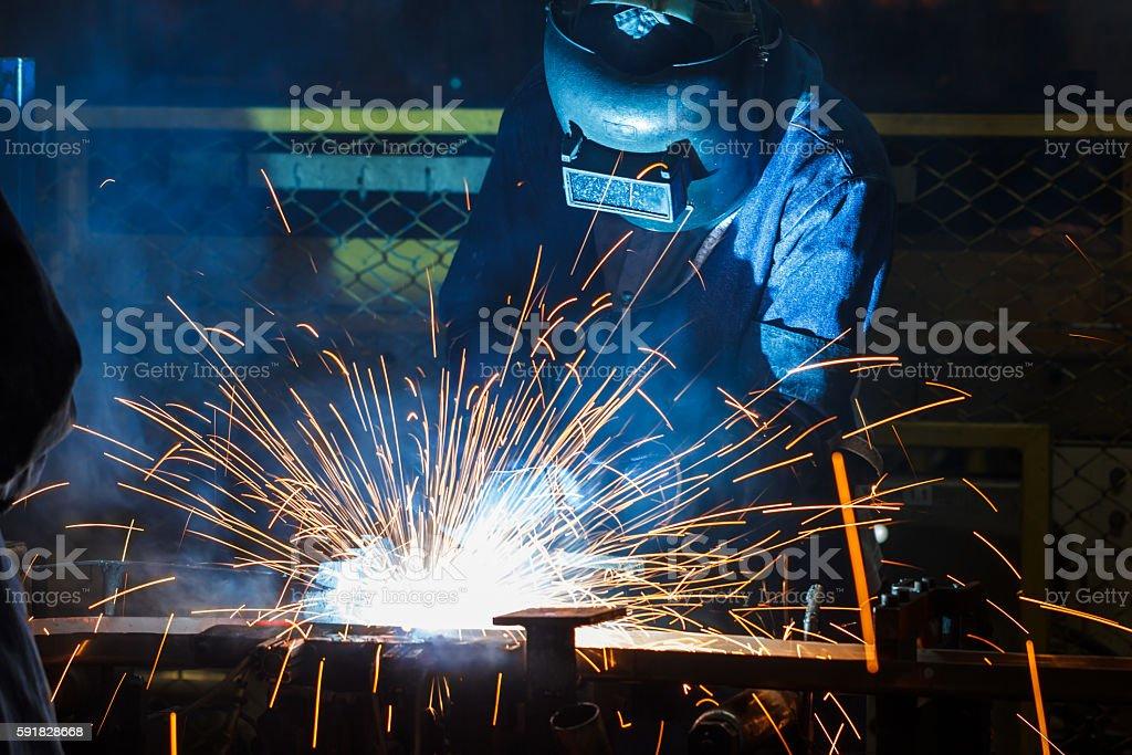 people welding industry stock photo