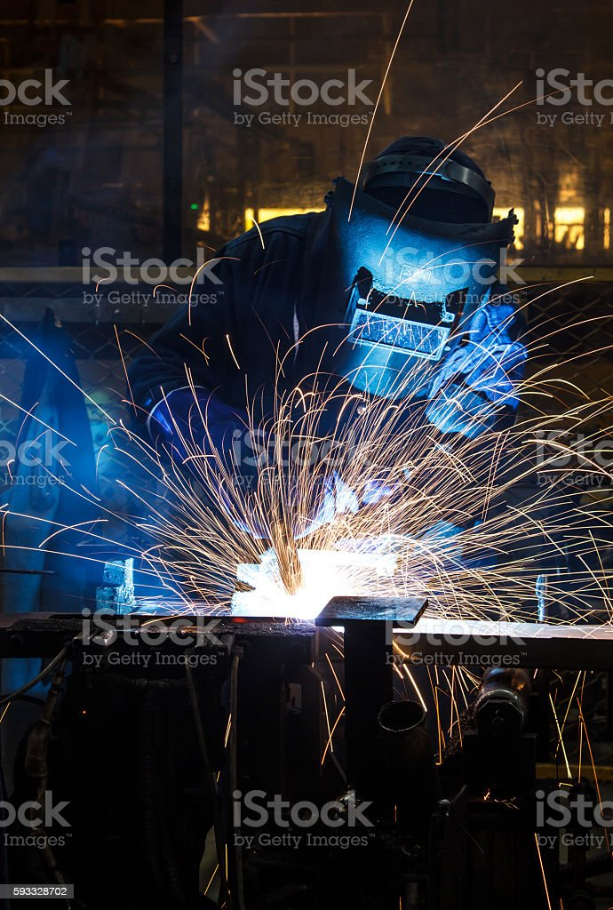 people welding industry stock photo