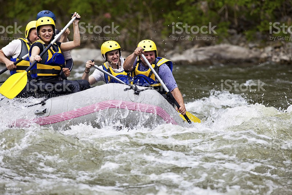 People whitewater rafting stock photo