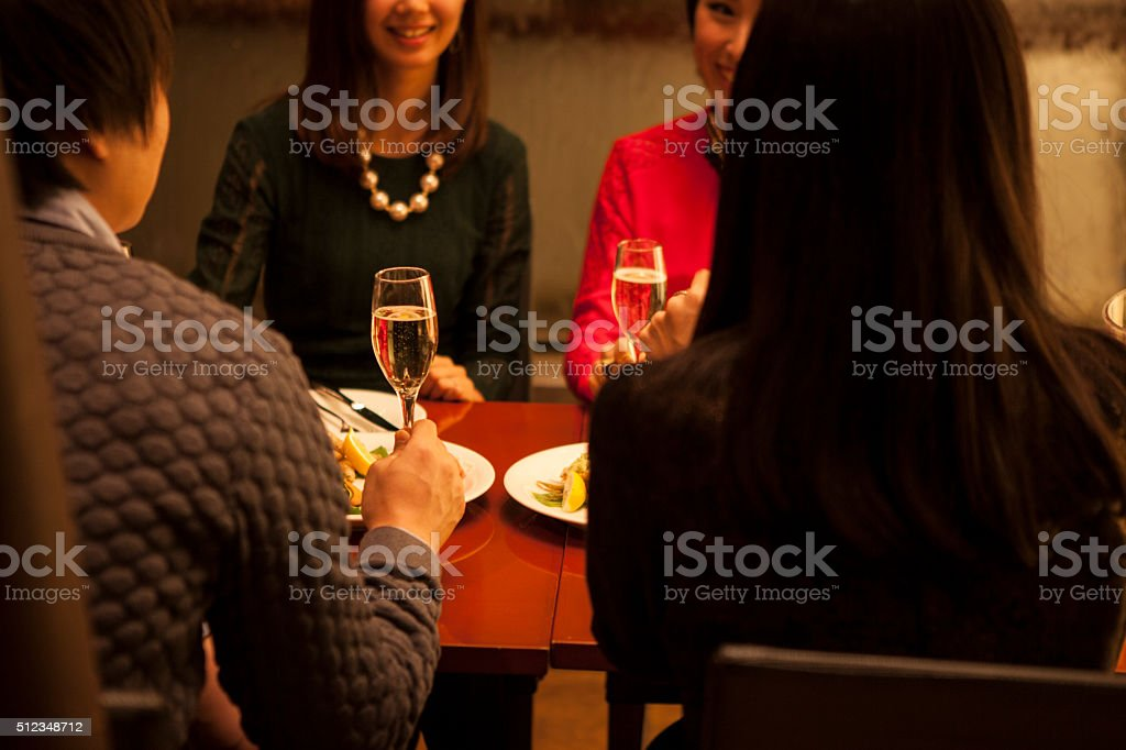People who are chatting in the restaurant stock photo