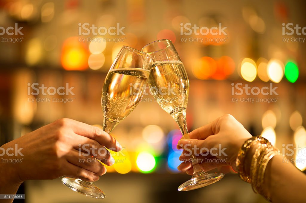 People who are to toast a champagne glass at bar stock photo