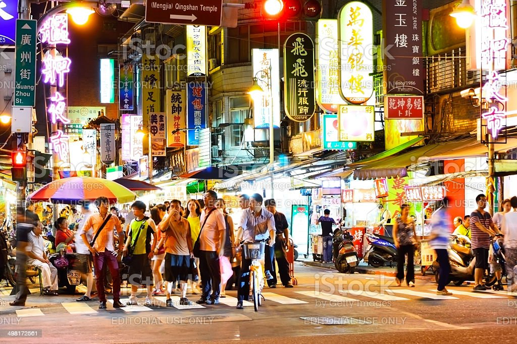 people who shopping in Wanhua District at night stock photo