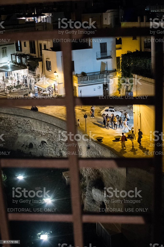 People who walk in the center of Otranto stock photo