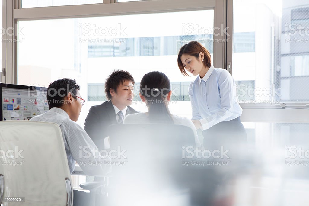 People who work diligently in the office stock photo