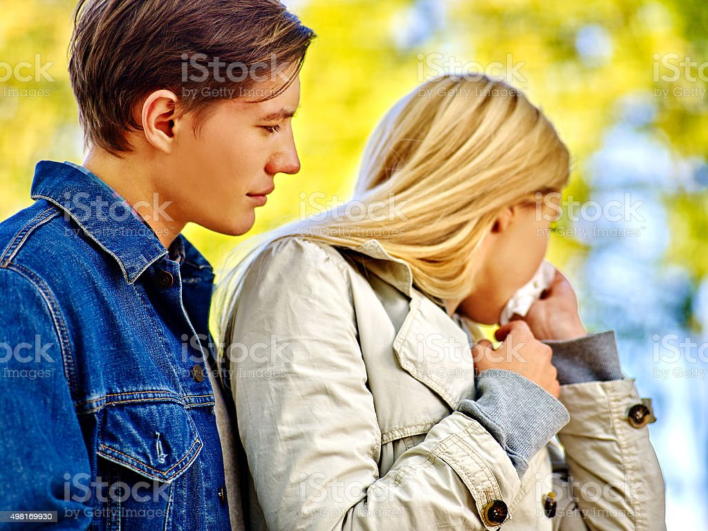 People with a cold blowing nose  handkerchief fall outdoor stock photo