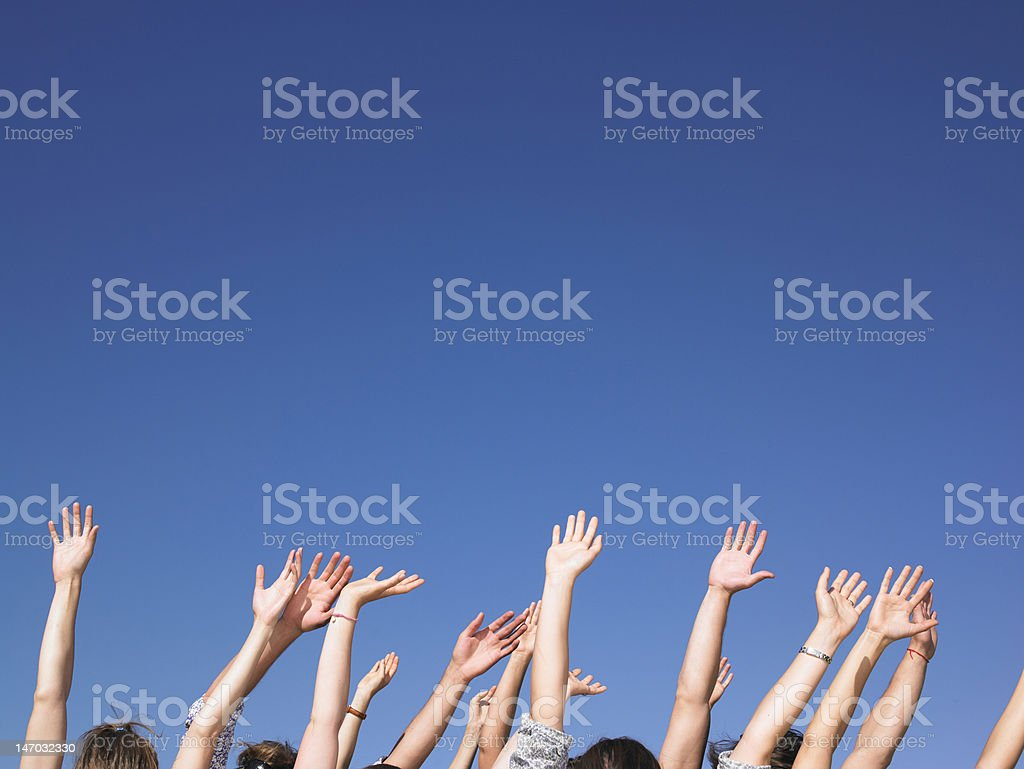 People With Arms Raised royalty-free stock photo