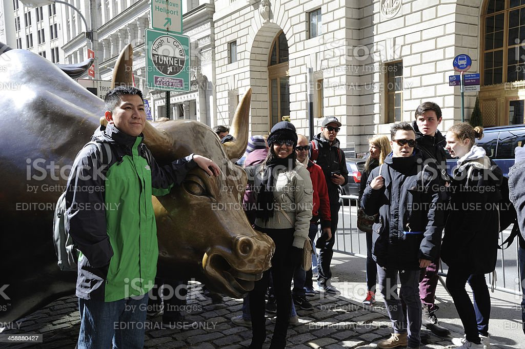 People with Charging Bull royalty-free stock photo