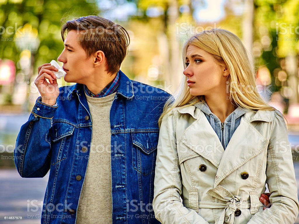People with cold blowing nose handkerchief fall outdoor. stock photo