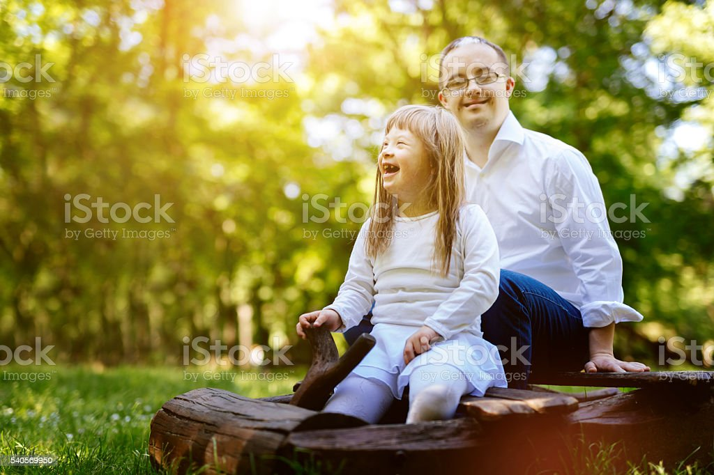 People with down syndrome happy outdoors stock photo