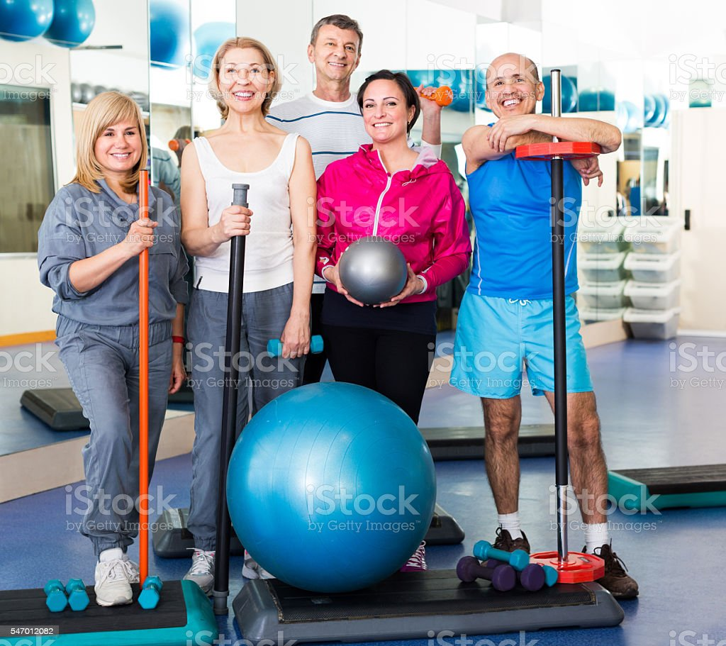 people with dumbbells and sticks stock photo