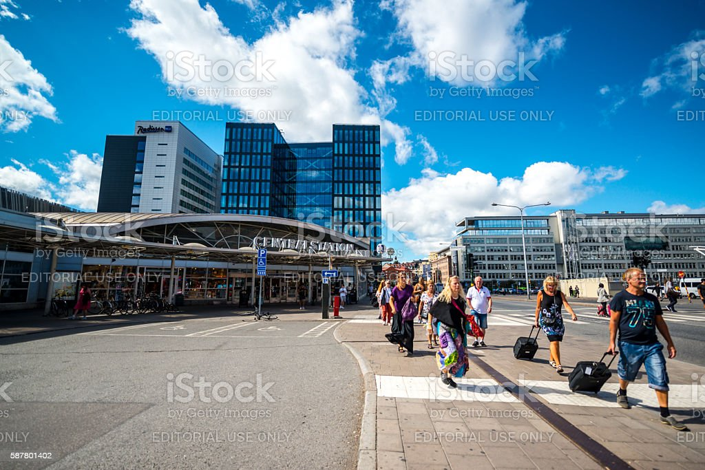 People with luggage walking from Stockholm central station stock photo
