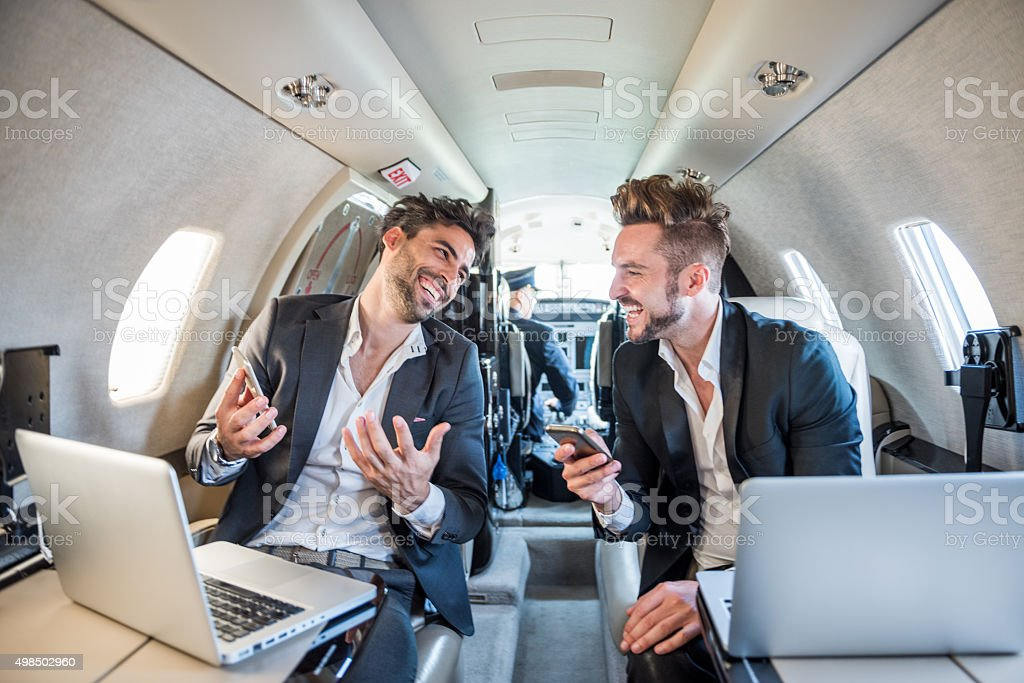 People with notebooks in private airplane stock photo