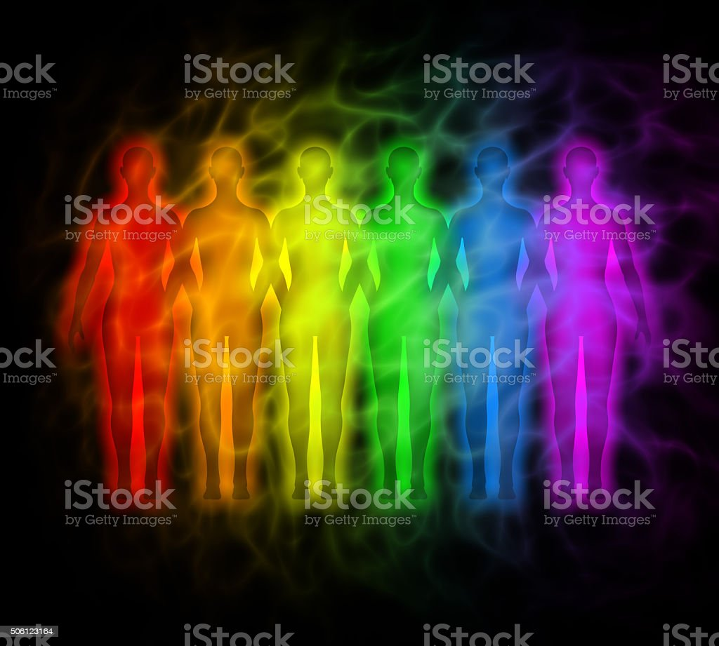 People with rainbow silhouettes of human aura stock photo