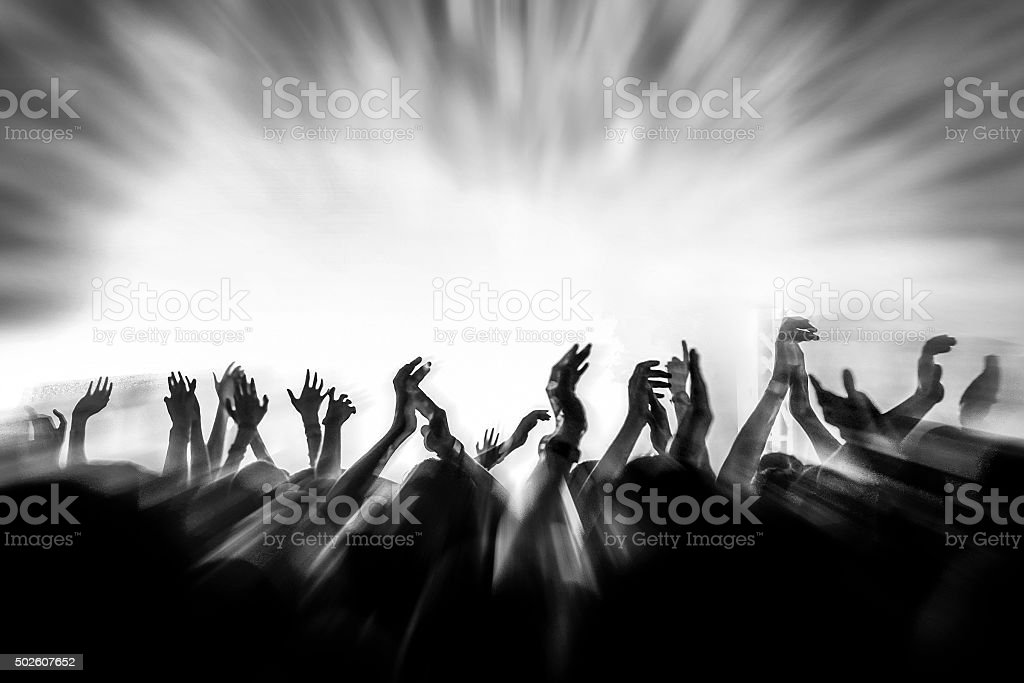 People with raised arms stock photo