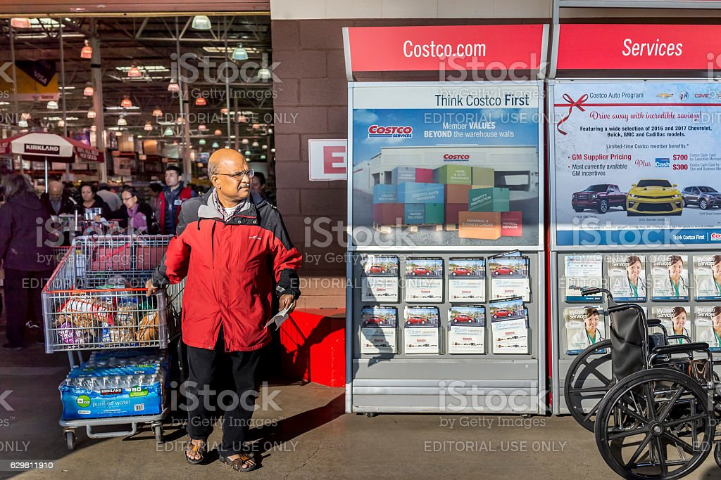 People with shopping carts fill royalty-free stock photo