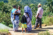 People with traditional clothes discussing at Mayotte island, Fr