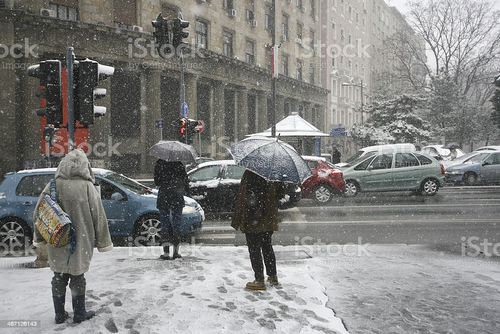 People with umbrella during snow storm car pedestrian stock photo