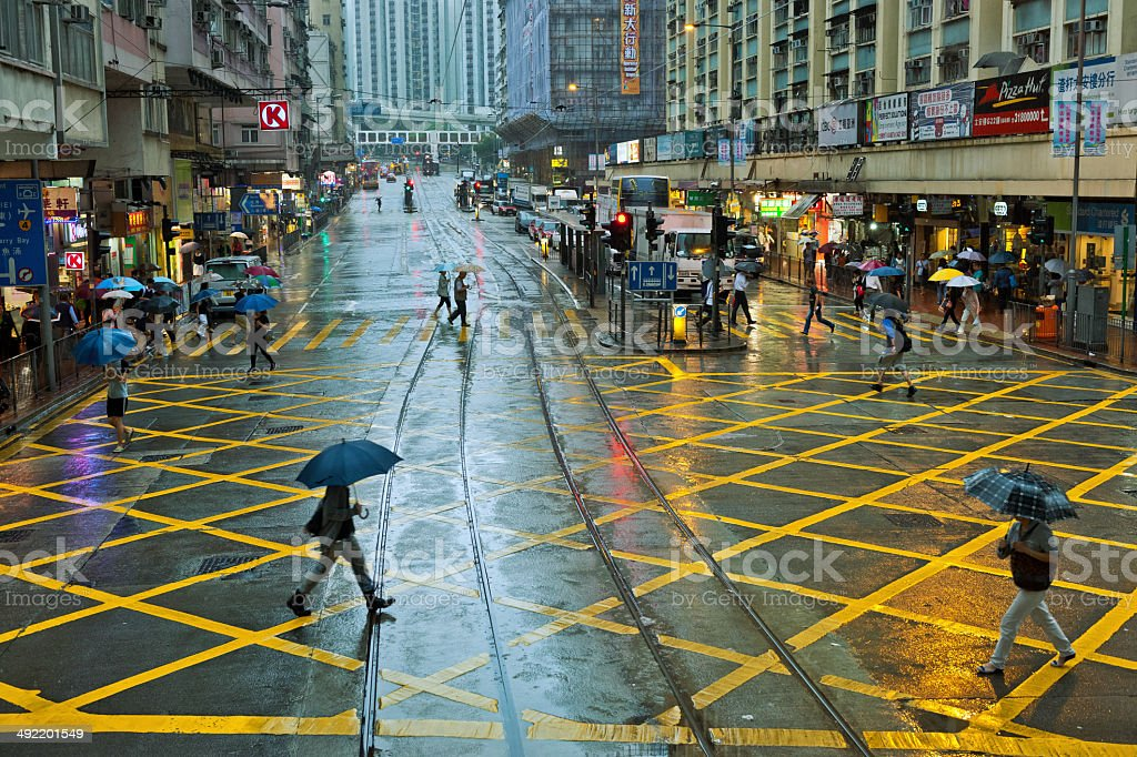 People with Umbrellas on Streets of Hong Kong, China, Asia stock photo