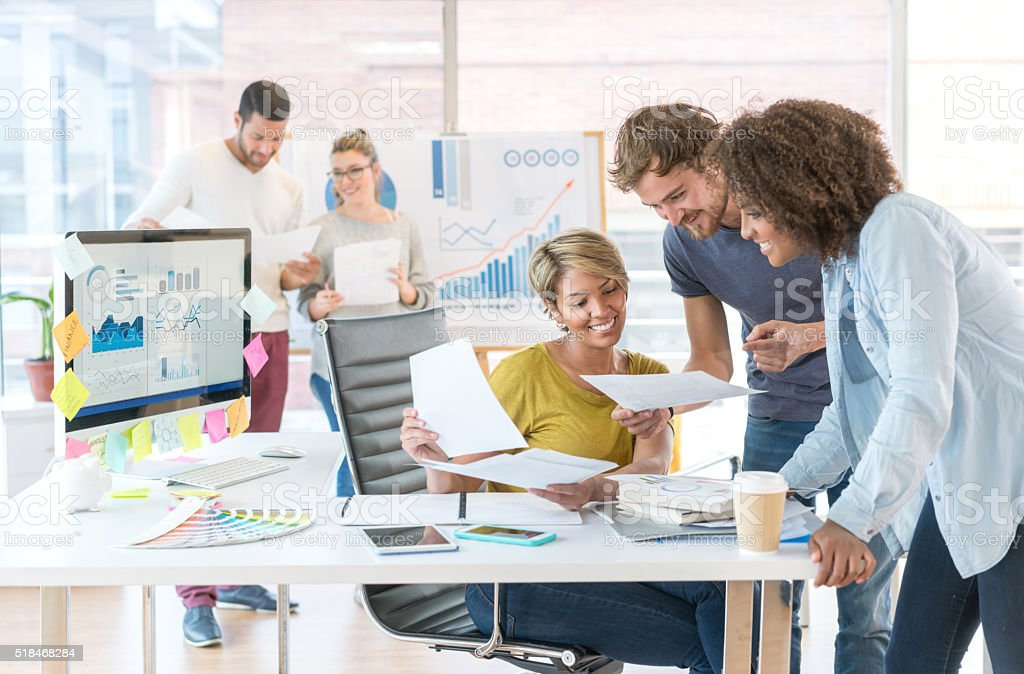 People working at a creative office stock photo