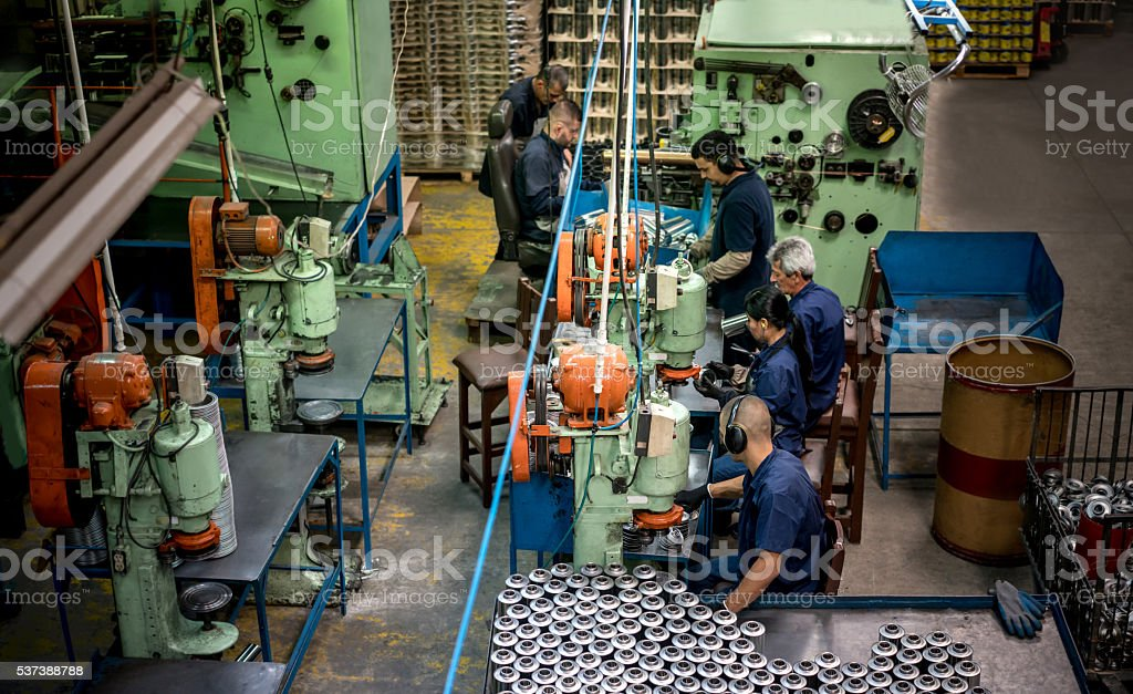 People working at a factory stock photo