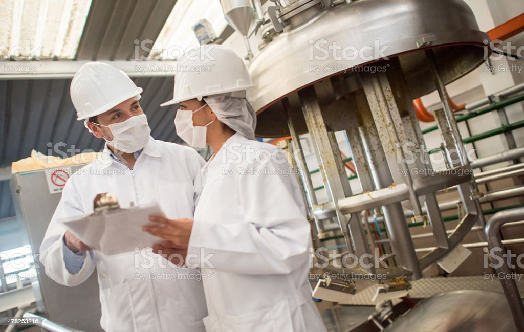People working at a food factory stock photo