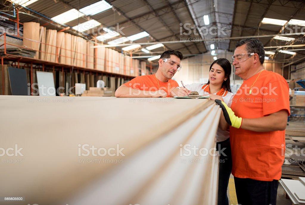 People working at a lumberyard stock photo