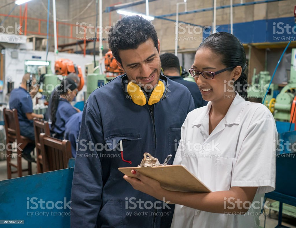 People working at a metal factory stock photo