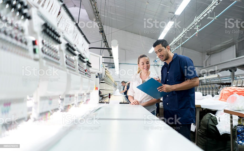 People working at an embroidery factory stock photo