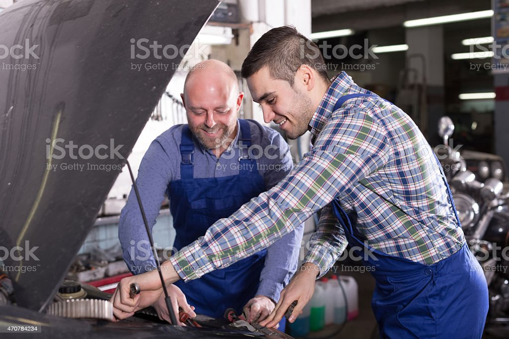 people  working at carshop stock photo